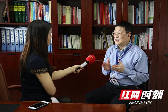 周智广:信息化建设优先 让老百姓在家门口看好病