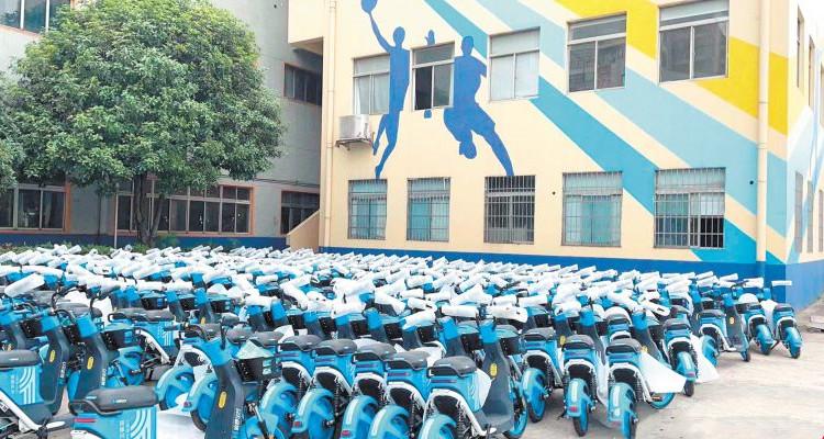 长沙5万台共享电动自行车新装上路 不戴头盔骑不走哦